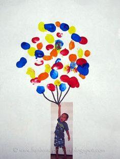 Leuk knutselidee voor een woensdagmiddag: foto van de peuter in kwestie, hangend aan een vingerafdrukballonnenbos!