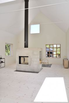 Swedish Contemporary Home Design with Comfort Interior: Warm Interior Of Wiklands Supported With Fireplace Divider With Black Pipe Chimney S...