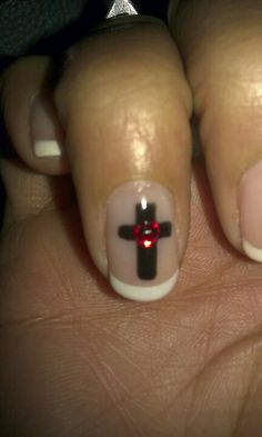 This was my Easter nail design. Simple french manicure with a cross and a red heart charm.
