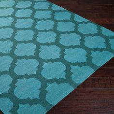 Tiles Rug, Teal made by Summertime Decor .