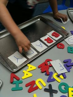 Match magnetic letters to letters written on paper. Lay out name in cards, kids match letters and 'write' their names!