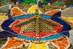 What can you do with 100,000+ #plastic #bottlecaps? Ask artist Bryant Holsenbeck. #litter #art Close up of the Cornelius Mandala--Markers of our LIves--photo David Borack