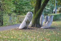 This amazing sculpture is called 'The Caring Hand' and is located in Glarus, Switzerland.