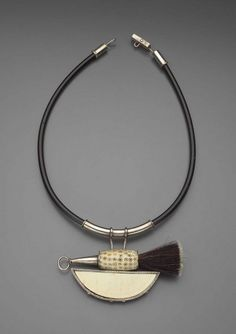 Necklace |  Ramona Solbert, 1999.  Rubber tube, sterling silver, brush, bone and ivory.