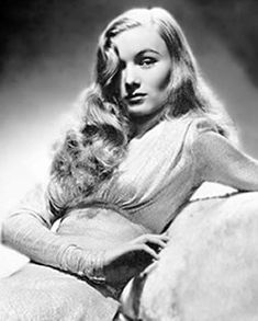 The style made famous by 1940s starlet Veronica Lake is the kind of 1940s hair that never goes out of fashion, and it's super-stylish.  Wash hair and dry until it is barely damp.  Part your hair deep on one side.  This is important to get the peek-a-boo effect over one eye.    Using a 1-inch diameter curling iron, curl small sections of hair, beginning at the top. Each time, do not unwind the curling iron, but open it up slightly and slide the curl off the barrel. Then pin the curl in place wit...
