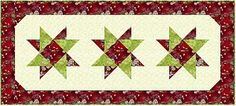 Spinning Stars - Learn how to use the Square in a Square ruler.  Free Tablerunner Pattern