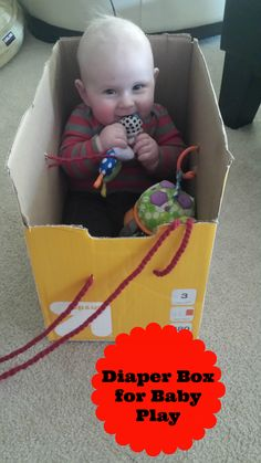 Using a diaper box for infant play!  Much better option than a jumparoo, exersaucer etc as it provides child with info on where they are in space as an added benefit!