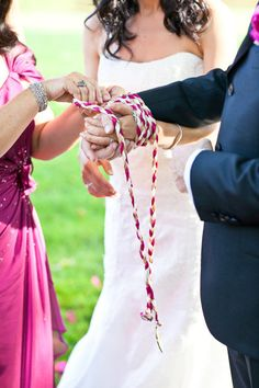 "An old Celtic wedding tradition: Celtic Handfasting ceremony. This is where they got ""tying the knot"" from. Family tradition will be continued"