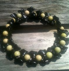 Idea for use of vertical hole beads - Memory Wire Black Bow Bracelet by By5Jewelry on Etsy, $7.00