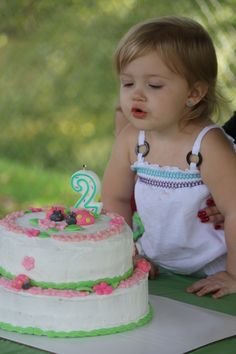 Kbug blowing out her candles on her ladybug cake :)