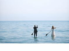 Paddleboarding bride and groom.