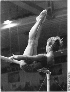 Gymnast Karin Janz performing on uneven bars (1970).