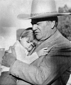 John Wayne on the set of The Big Jake, embracing his 3 years old grandson Michael Ian.