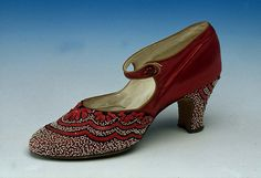 Shoes: Bar Shoes retailed by Harrods Ltd (1925)    Red satin, bead embroidered, pointed toe. 2.6 inch embroidered louis heel. Bar to button over instep. Made in France.
