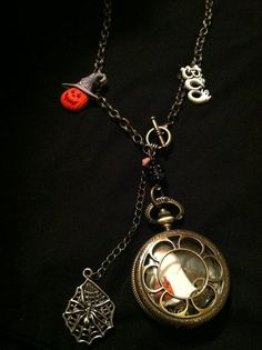 """Watch with Halloween ghost inside. On 30"""" brass chain """"Boo"""" and jack o lantern charms $28"""