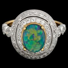 Antique Oval Black Opal And Diamond Cluster Ring