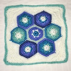 "Day 17: 12"" Block of the Day - Hexagon Hotpad Square by Julie Yeager  Free Pattern: http://www.ravelry.com/patterns/library/hexagon-hotpad-square   #TheCrochetLounge #12inch #grannysquare Pick #crochet"