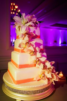 4-tier square wedding cake decorated with orchids