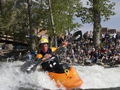 Spring in Reno Tahoe - Kayakers challenge the Truckee River's large rapids in downtown Reno, as the snow melts in the Sierra.
