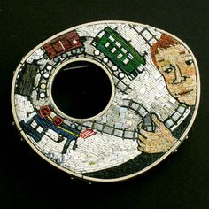 "Cynthia Toops: Choo choo, Mosaic brooch in polymer clay with sterling silver bezel by Chuck Domitrovich. Approx. 2 1/2 x 2 1/8""."