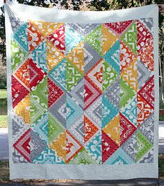 wow. just love this. great use of the new half moon modern fabric from mode.   free tutorial!