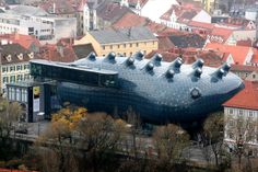 Kunsthaus Graz (also known as the Graz Art Museum or the Friendly Alien), designed by Peter Cook and Colin Fournier, opened in Graz, Austria, 2003.