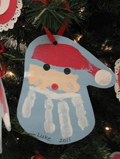Chirstmas craft idea for kids. Paint and handprint to make Santa.   best stuff