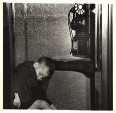 Sleeping in a phone booth, New York 1945 by Weegee