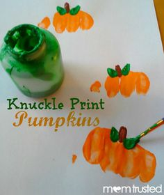 A great Preschool Pumpkin Project: making pumpkin prints with your knuckles. #kids #preschool #diy #easy #prek #kindergarten #craft #keepsake #happyhalloween #thanksgiving #children #toddler #october #november #paint