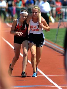 The moment in which this Ohio athlete stopped to help an injured competitor across the finish line during a track meet: 17-year-old Meghan Vogel was in last place in the 3,200-meter run when she caught up to competitor Arden McMath, whose body was giving out. Instead of running past her to avoid the last-place finish, Vogel put McMath's arm around her shoulders, carried her 30 meters, and then pushed her over the finish line before crossing it.  Image by The Daily Call, Mike Ullery / AP