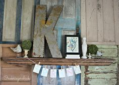 Check out this wall! Part of a junk inspired spring mantel by  {Onekriegerchick.com}