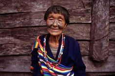 Women of the Derung ethnic minority in the Yunnan Province, China used to tattoo their faces as a symbol of beauty. The practice is now extinct, but the older women wear the history.
