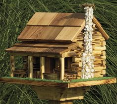 Amish bird feeder with rock fireplace