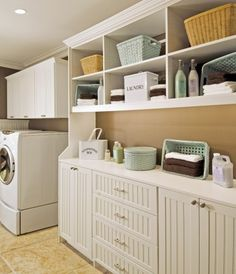 Laundry room - open storage with baskets. I want to do this. Looks clean and organized.