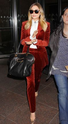 Elizabeth Olsen in a velvet suit.