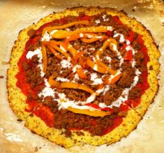 Our cauliflower pizza crust is one of our staples on Phase 1 of Ideal Protein.  We'll use the chunky sauce at the bottom of the recipe, and cover it with veggies and lean taco meat or home made lean pork sausage.  It's good stuff!