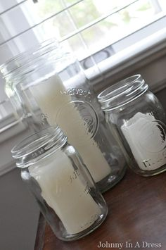 Love these pillar candles in mason jars