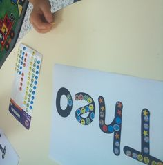 Writing their names using stickers. Great fine motor activity!