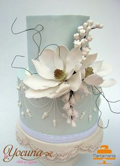 magnolia cake, tiered cakes, white magnolia, flower designs, blue cakes, white wedding cakes