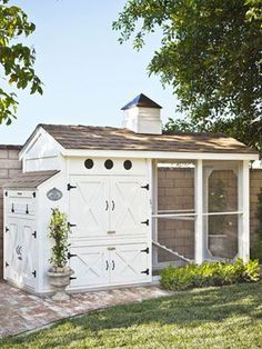 "How to Build the Ultimate Chicken Coop | ""No one wants to look at chicken poop,"" Heather points out, ""so we planted boxwoods out front to hide the coop floor."" The couple also surrounded the structure with an attractive brick walkway, which they can simply hose off as needed."