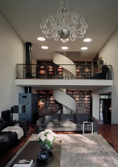 This stunning living room and library. Love the stairs!