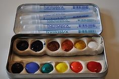 DIY watercolor paint tin. The paint wells are made from polymer clay.