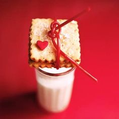 #Valentine cookie served with a glass of milk