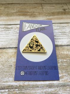Deathly Hallows pin,