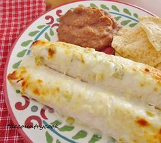 Creamy Chicken Enchiladas  (similar to mine except I use cream cheese instead of sour cream in the sauce)