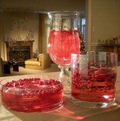 Floating tealights in cranberry water.