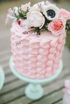 Pink wedding cake topped with flowers