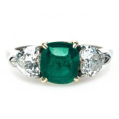 Mint Julep is a sweet vintage emerald and diamond engagement ring featuring a 2.60ct emerald cabochon surrounded by two heart-shaped diamonds. TrumpetandHorn.com // $6,400