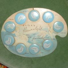 "Vintage Avon ""Heavenlight"" Powder Tins Display"