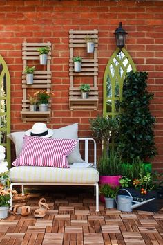 Pack Personality - Decorate garden walls with mirrors and trellises to add personality to your outside space.